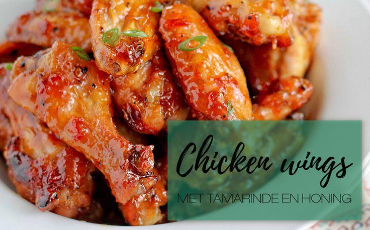 CHICKEN WINGS MET TAMARINDE EN HONING - Deze kippenvleugels met tamarinde en honingsaus zijn perfect als hapje, op een…