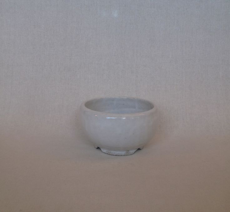 Thrown pot with notched foot ring and white crackle glaze by Janine Flew
