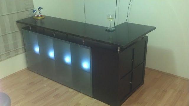 Bar using Ikea Expedit shelves, Capita legs, + counter top.