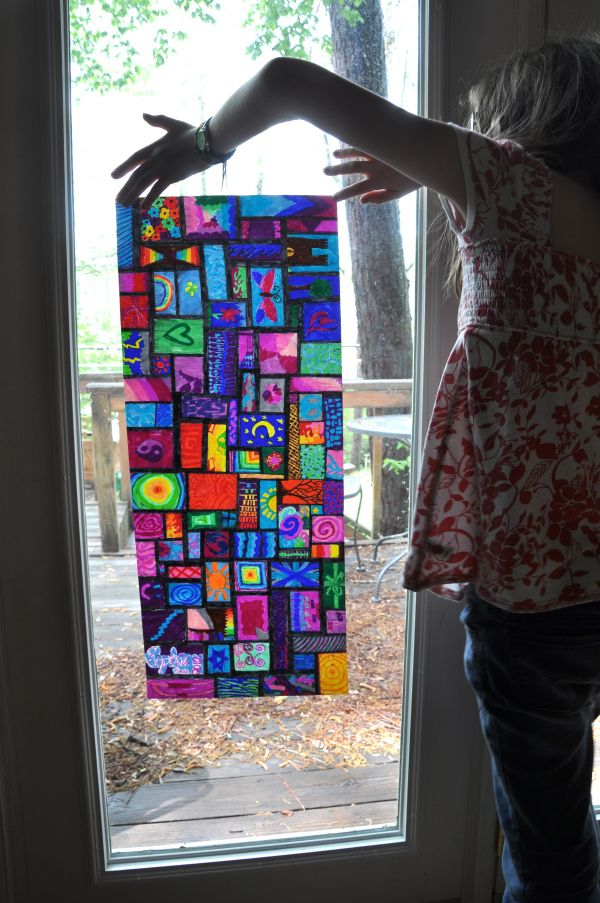 """gorgeous """"stained glass"""" art: use Sharpies to color on """"cheap paper on a roll from a toy store. the paper has to be thin to allow the light to come through."""" don't use freezer paper or wax paper, tho"""