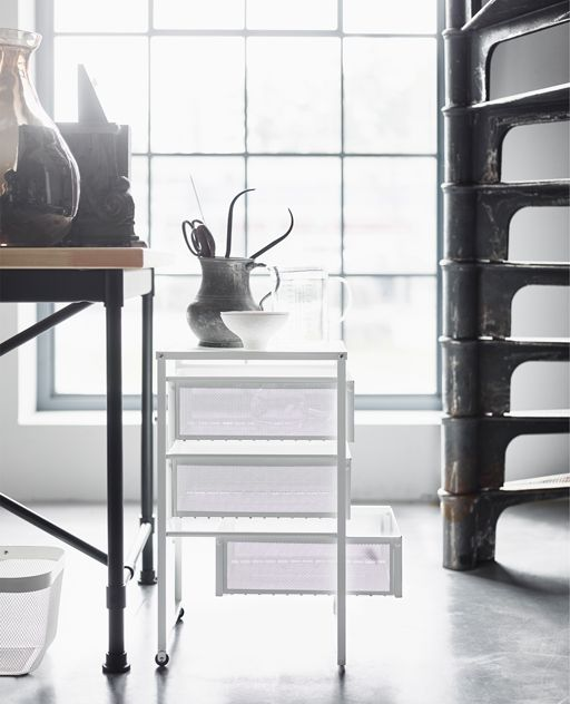 We think using combining industrial furniture with lighter furniture like this mesh drawers is an upcoming trend