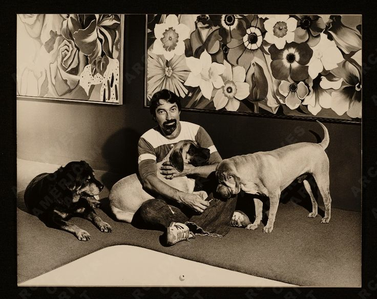 Lowell Nesbitt sitting with his dogs