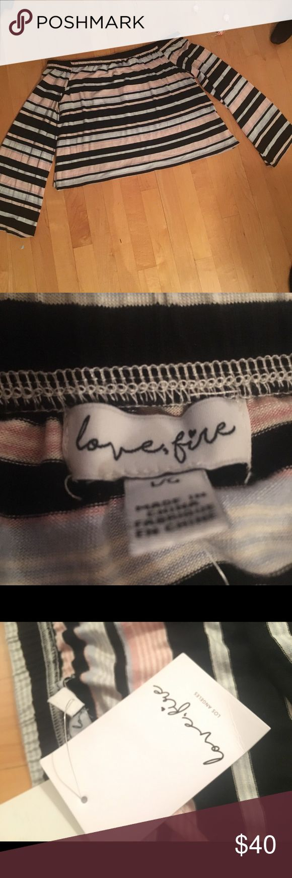 love, fire off the shoulder long sleeve top Love, fire off the shoulder long sleeve top. Multi-colored striped top. Material feels very comfy! Love, Fire Tops