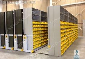 compress storage shelving bins warehouse shelves rolling on rails to compress together