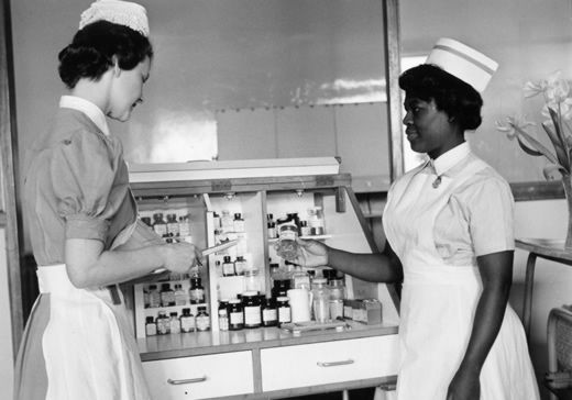 Until 1986, there was a two-tier system of nursing training: staff and pupil. The 'Staff' or State Registered Nurse (SRN) qualification included training in ward management, while the 'Pupil' or State Enrolled Nurse (SEN) qualification concentrated on the clinical side of nursing. Most Black nurses, were placed on the two-year SEN course. Due to racial discrimination few were accepted on the SRN despite possessing the requisite qualifications.