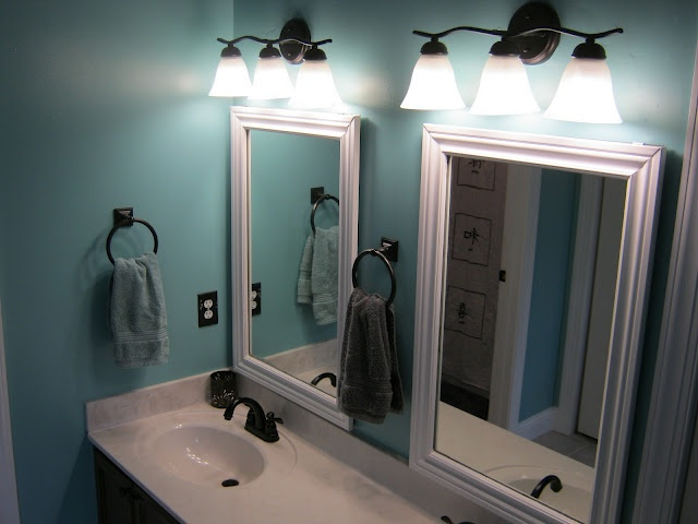 Framed bathroom mirrors. so much cuter than a huge ugly mirror with no border. i want!