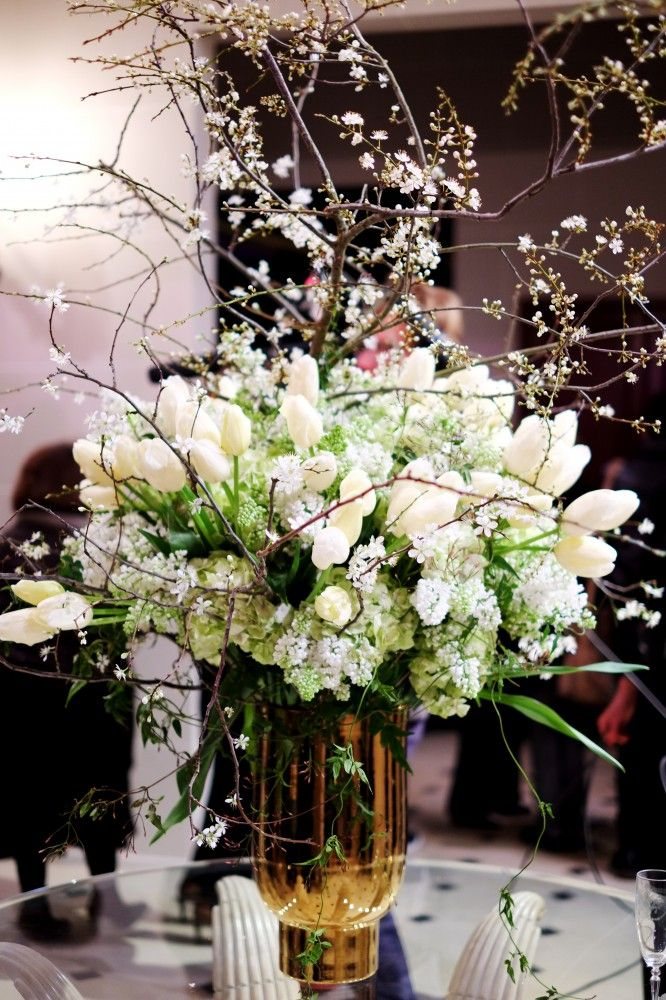 The sticks make it look vintage but elegant!!  Would look beautiful in Red Tin Barn for wedding reception.  Could even put in smaller vases!  gorgeous arrangement....