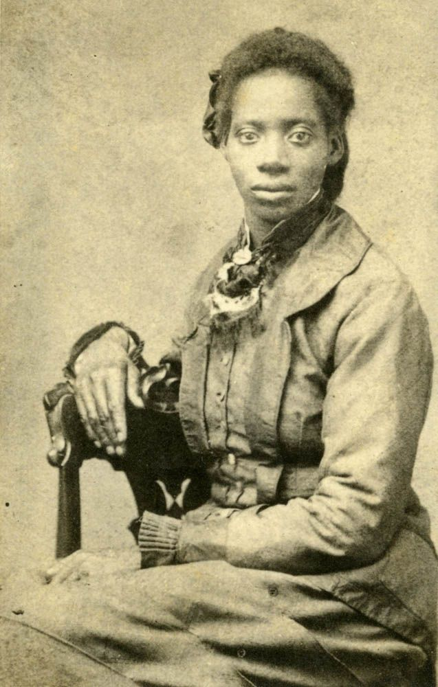 "Rhoda Ray was born about 1824, a slave of John Ray. During the Battle of Wilson's Creek, Rhoda and her children first sought shelter in the cellar of the Ray house, then helped treat the wounded after the house was occupied as a Southern field hospital. Rhoda was freed in 1865 and moved to Springfield, Missouri, where she married John Jones. She ""took in laundry"" and he worked in a stone quarry. [Photo was taken at Springfield, circa 1897, but ""Slave of GrandMother Ray"" is written on the…"