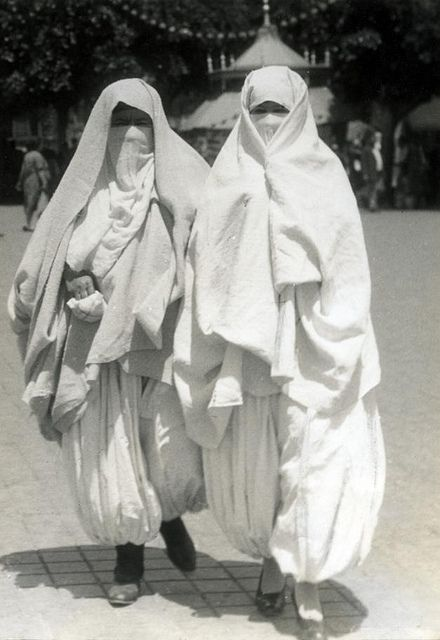 Two veiled Arabic women wearing chalwars. Algiers, 1932.