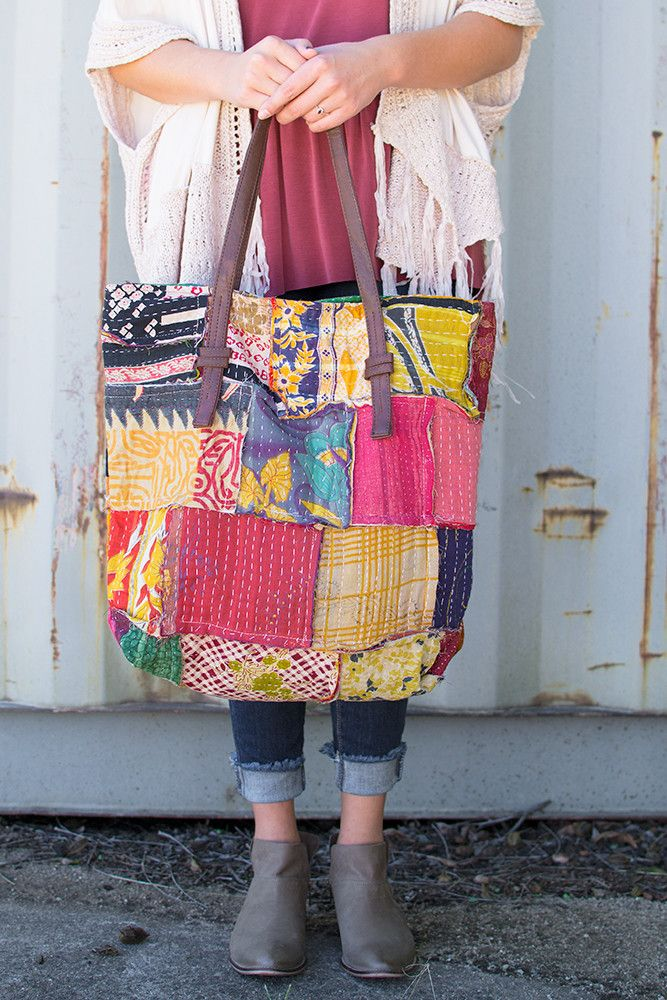 Traveling gypsy! Hello patchwork and hello gorgeous! This large oversized tote by American & Beyond is all things boho and vintage. Brown leather straps contrast nicely with the multi print, multicolo