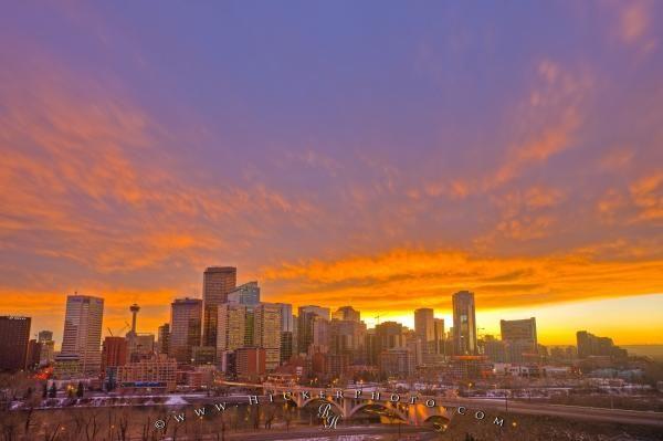 Vivid Sunset Skyline Over Bow River & Centre Street Bridge Calgary Alberta Canada.  www.hickerphoto.com