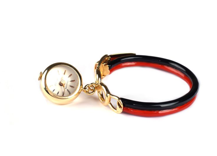 A metal gilt Gucci vintage bracelet with clock - 1970/80s Lot 329