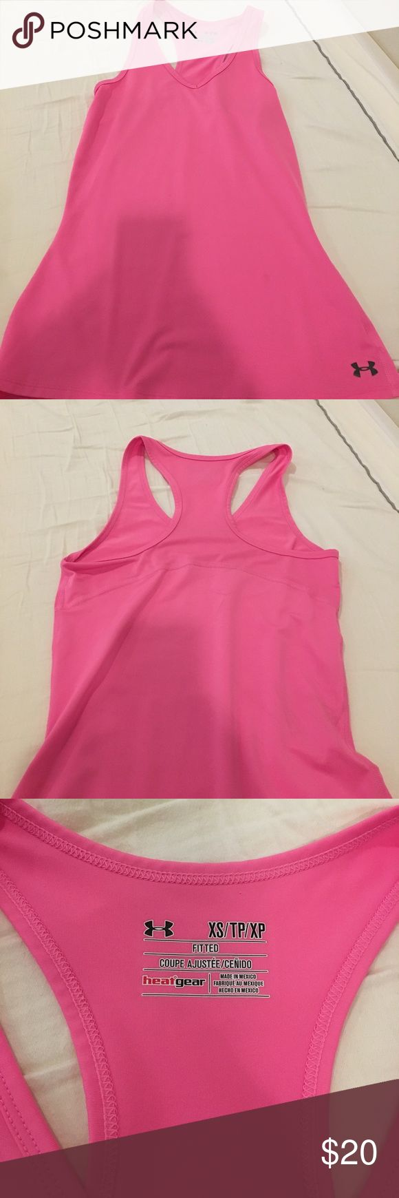 under armor workout tank it's a pink racer back tank. only worn a few times Under Armour Tops Tank Tops