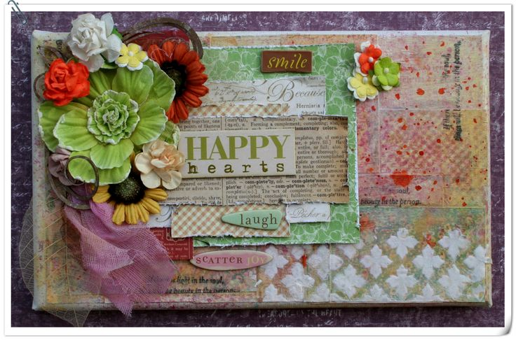 Playing with graphic 45 and mixed media.  All the paper on this mini canvas comes from my graphic 45 scraps.
