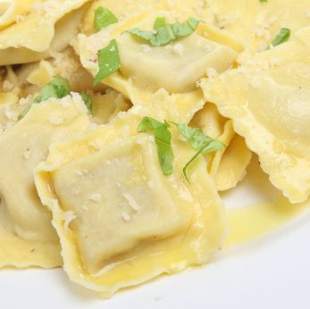 Easy ravioli made from won ton wrappers!  I made these at my mom's house this weekend with my kids and they were a huge hit.  They were so simple that my 6 year old played a major role in putting them together.  We did cheese only-- motzarella and ricotta.  We served with both a marinara and an alfredo.  Very easy and very good.