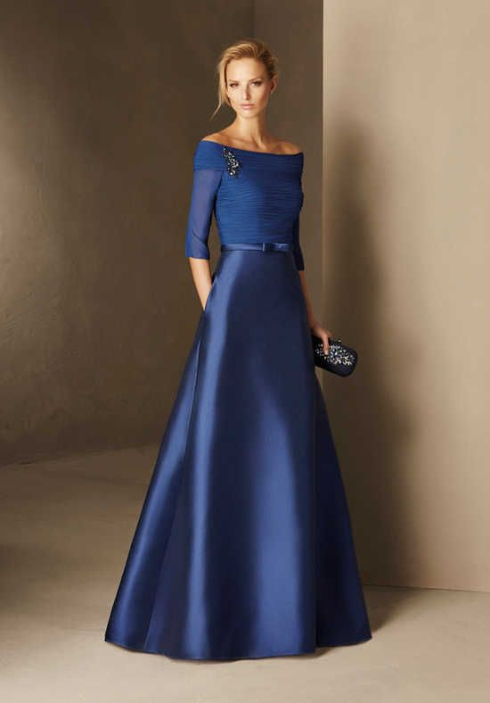 This cocktail dress captivates at first sight. It bursts at the seams with elegance, in every single detail and in the careful gemstones on the bodice. A precious design in crepe, soft tulle and thread embroidery, with a bateau neckline and mermaid cut. A design created to outshine. The Knot provides price estimates to give you a general idea of the cost of a dress. Please visit retailers in your area for exact pricing. Prices will vary by region.