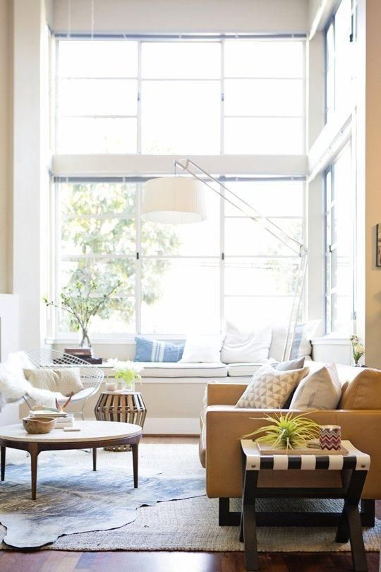 """""""Start with a well-lit space. The rest is easy if you're willing to ignore the rules, be creative and patient. Great interiors come together over time. We also find that groupings of things look best when balanced with empty or minimal areas."""" Start With Good Lighting and More Advice On Filling a Home"""