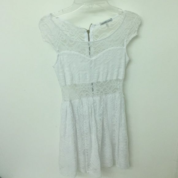 White lace dress Its originally bought from Charlotte Russe. Worn once. In great condition. Has a see-through fabric located at the mid-waist. Charlotte Russe Dresses Midi