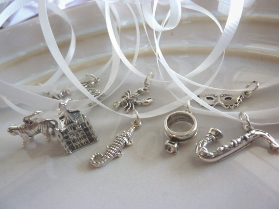 Set of nine traditional sterling silver New Orleans cake pulls for your wedding cake.
