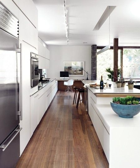 Galley kitchen, different heights countertops, lights?  Sleek Contemporary Kitchen | House & Home
