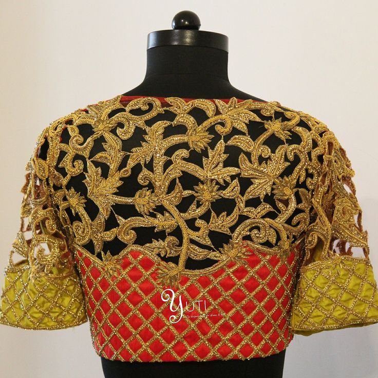 A bright red and green cutwork  blouse studded with swarovskis from yuti. Contact : 044 42179088.