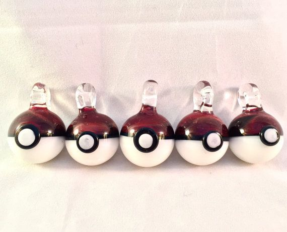 Glass Pokeball pendant made from borosilicate colors Ruby, Garnet, black, and white.  Bail diameter is 5mm  Dimensions: 1 and 1/2 in. tall x