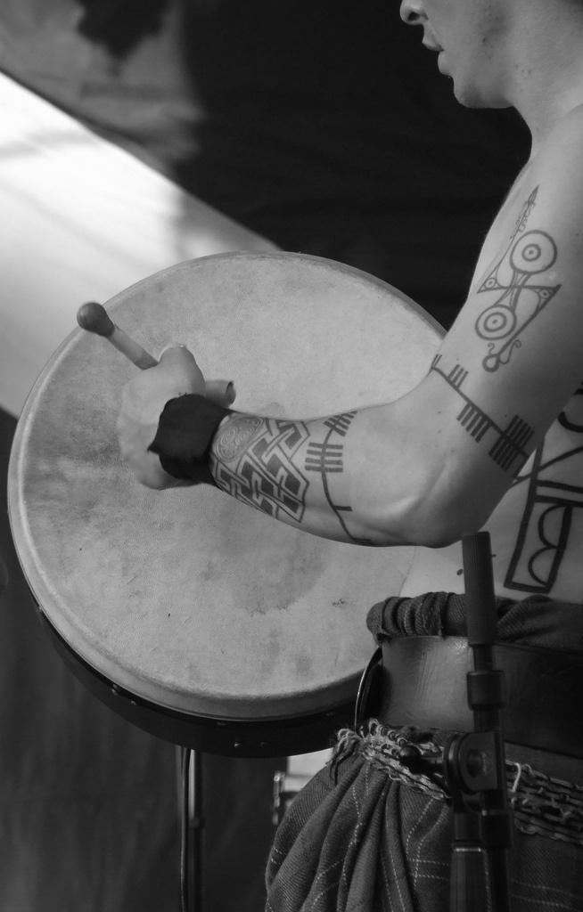 Tats of a band member of the Scottish tribal drumming band Albannach. Photo by Melissa Shigley