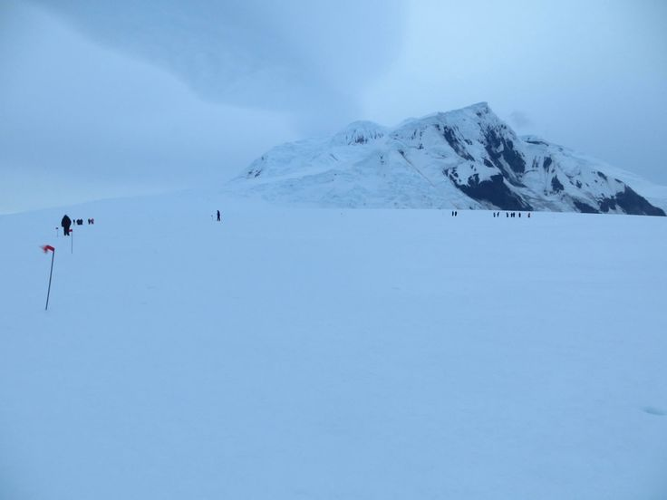 The #caldera of Mount Lars #Christensentoppen towers above our ice ridge, 1,640 metres of pure andasite capped with ice that slumps in places, threatening to tumble into the sea.