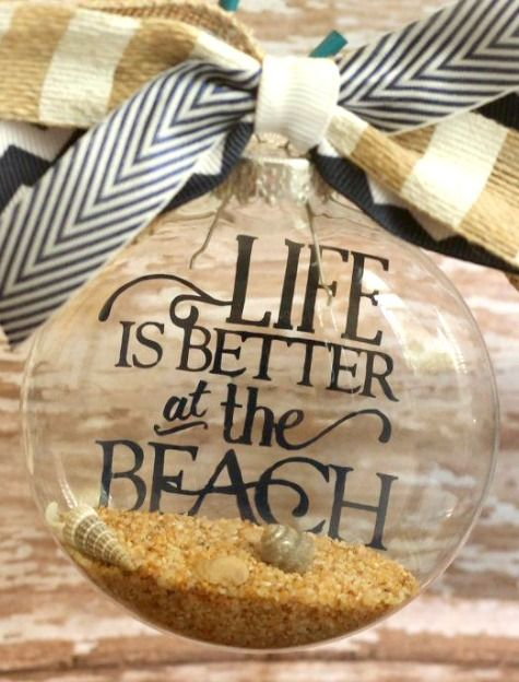 Handmade Clear Ball Ornament with Beach Quote using Vinyl Letters: http://www.completely-coastal.com/2014/11/handmade-coastal-beach-christmas-ornaments.html