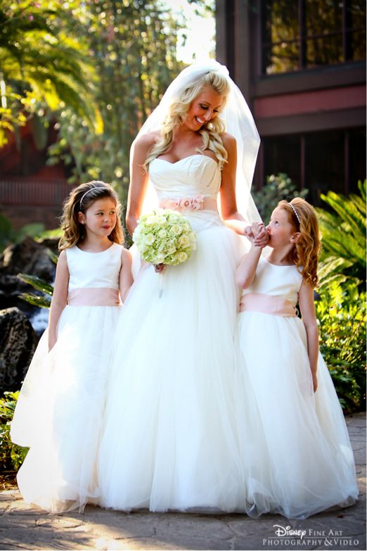 Match your gown to your flower girls' dresses for a seamless procession – and great photo ops! #sash #pink
