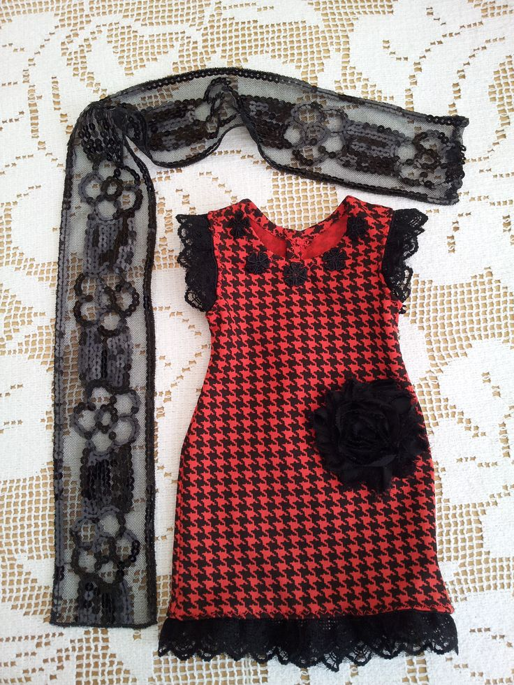 Red and black dogtooth stretch fitted dress with giant black rose and lace trim. Black lace & sequins scarf.