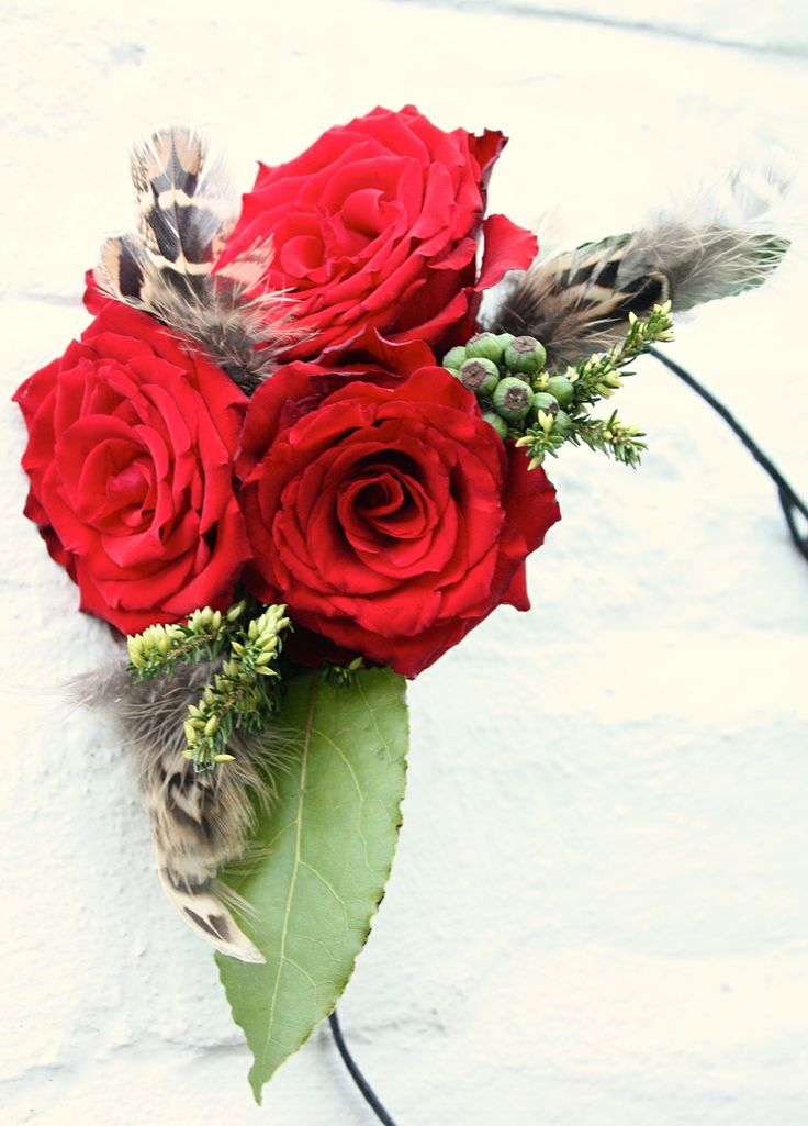 Red rose & feather for a winter wedding.