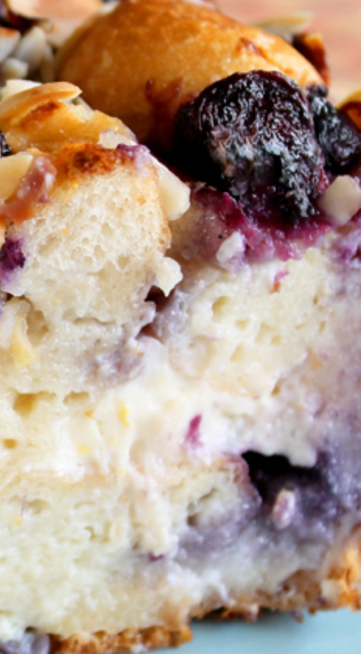 Blueberry Cheesecake Bread Pudding ~ From the crunchy almonds on top, to the tart berries bursting throughout, to the rich, creamy cheesecake filling, this is one delicious, decadent brunch dish.