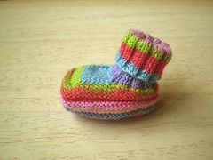 These Baby Boots are knitted in sockweight 4 ply yarn and the foot is about 8 cm long. Larger sizes can be made by adjusting the needle size and the foot is worked in a stocking stitch welt to allow for growth. The boots are worked in one piece and then joined along the back of the cuff and the middle of the sole.
