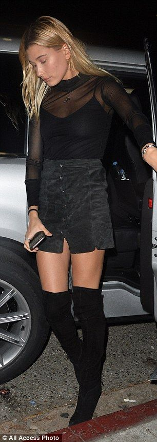 Fashion princess: She wore a sheer mesh top over a black vest top and teamed it with a Nin...