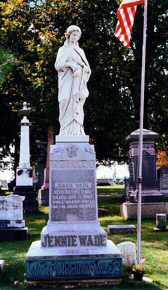 Statute at Jennie Wade's gravesite in Evergreen Cem. Gettysburg, Pa. Jennie was the only civilian to lose her life in the Battle of Gettysburg.   The Jennie Wade Monument reads:  (Front Side)  JENNIE WADE  AGED 20 YEARS 2 MO  KILLED JULY 3 1863  WHILE MAKING BREAD  FOR THE UNION SOLDIERS.  JENNIE WADE  MARY VIRGINIA WADE  Another side reads:  SHE HATH DONE WHAT SHE COULD