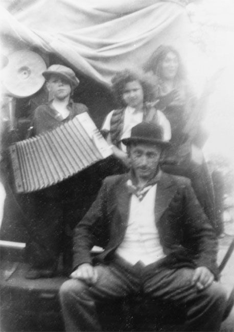 Marian Kaufman (upper row, center), with the gypsy family that sheltered her in Holland during the war