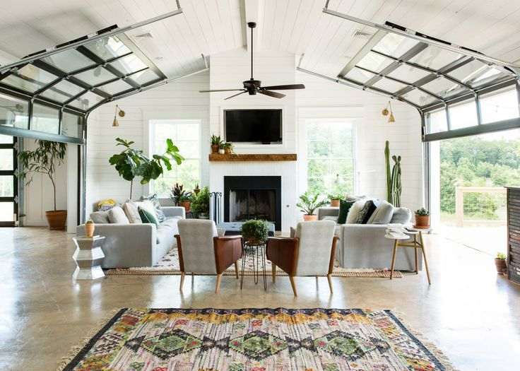 a Vintage Eclectic Barn with roll up doors in the living room | room of the week coco kelley