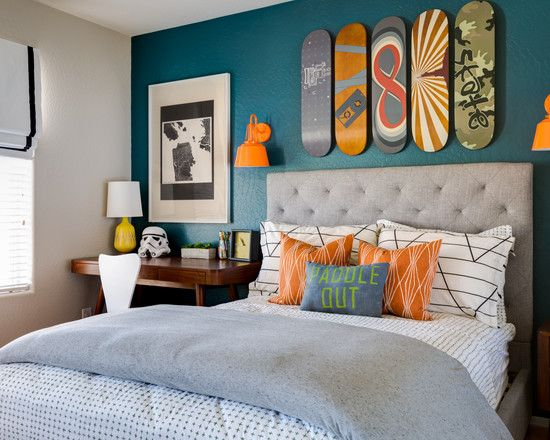 Snowboard room for kids, blue feature wall, orange accents, orange wall sconces | J & J Design Group, LLC.