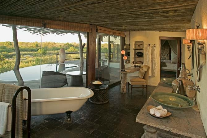 Private bathroom overlooking the Sand River @ Singita Boulders Lodge