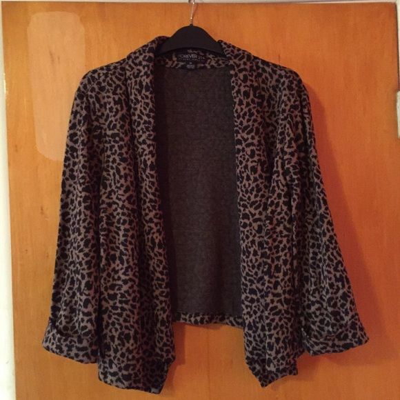 Leopard blazer F21 Plus size f21 leopard cardigan, the back is skittle shorter than the front. Only worn once- runs true to size. Not faded neither damaged Forever 21 Sweaters Cardigans