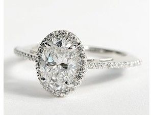 Oval Halo Diamond Engagement Ring. Absolutely freaking gorgeous. So unique, not many women have oval engagement rings anymore!!