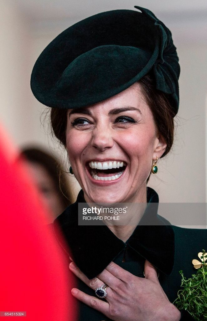 Britain's Catherine, Duchess of Cambridge reacts whilst talking with off-duty soldiers from the 1st Battalion Irish Guards, after watching their annual St Patrick's Day parade at Cavalry Barracks in Hounslow, west London on March 17, 2017. / AFP PHOTO / POOL / RICHARD POHLE        (Photo credit should read RICHARD POHLE/AFP/Getty Images)
