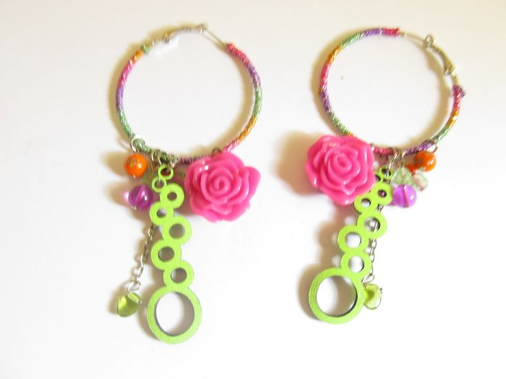 Handmade laser cut leather earrings (1 pair)  Made with light green leather filigree, silver tone antiallergic earring hoops with colourful fiber, plastic fuchsia flower and glass beads.