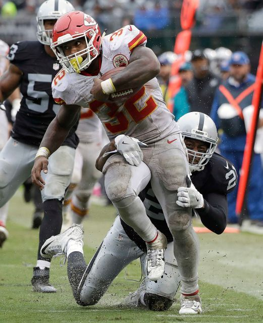 Chiefs vs. Raiders:    October 16, 2016   -  26-10, Chiefs  -    Kansas City Chiefs running back Spencer Ware (32) runs against Oakland Raiders cornerback Sean Smith (21) during the second half of an NFL football game in Oakland, Calif., Sunday, Oct. 16, 2016.