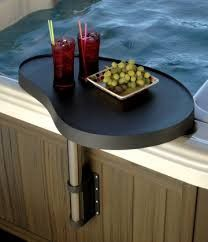 Spa Caddy A HANDY, SAFE PLACE TO PUT CELL PHONES, BEVERAGES AND MORE Sturdy and versatile, the SpaCaddy is a perfect solution to an age-old problem for spa users. Now all of that stuff — from food and