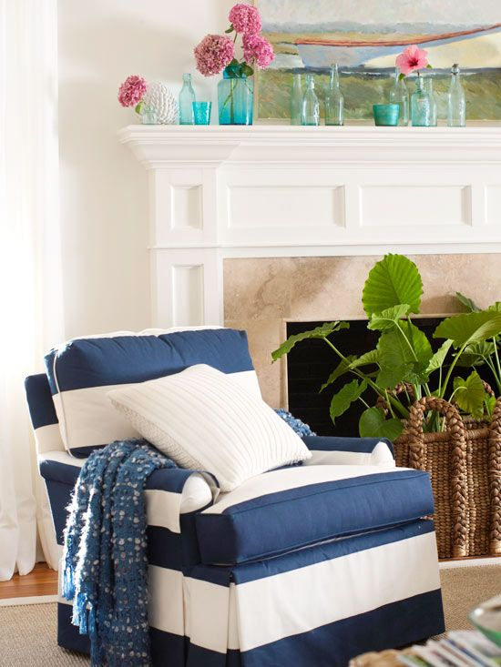 Navy striped chair, sea colored glass bottles, boat painting, and a green treatment for the fireplace hole.: Design Bedroom, Decor Ideas, Bold Stripes, Blue Glasses, Fireplaces Facelift, Stripes Chairs, Blue Stripes, Glasses Bottle, Blue And White