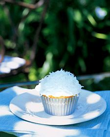 Coconut-Topped Cupcakes - Martha Stewart Recipes: Cupcake Recipe, Cupcakes Recipe, Coconut Cupcakes, Desserts Cupcakes, Easiest Cupcakes, Coconut Topped Cupcakes, Cupcakes Desserts
