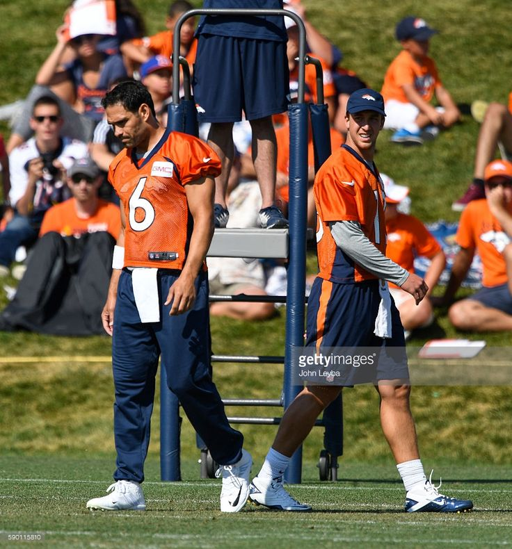 Denver Broncos quarterback Mark Sanchez (6) and Denver Broncos quarterback Trevor Siemian (13) runs through drills in practice August 16, 2016 at Dove Valley.