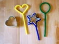 Use pipe cleaners as wands for bubbles. Other ideas:           a slotted spoon      funnels      fly swatters      a potato ricer      6-pack rings      a silicone steaming basket      mason jar lid rings      cookie cutters